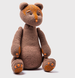 Light brown smiling HUGU with orange paws and stitching(order time 1 Month )